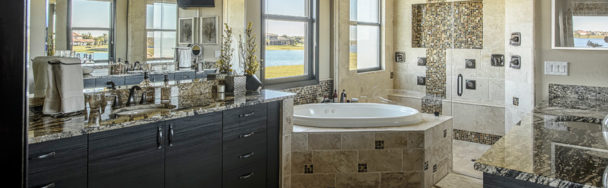 this spacious master bath has dual vanities and large walk-in shower