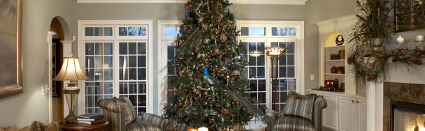 This shows a beautiful traditional Christmas tree and decor in copper and turquoise with natural textures