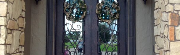 This dramatic entry is accented with Holiday decor in shades and textures of blue