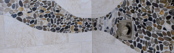 Detail of bath tile with mosaic pebbles